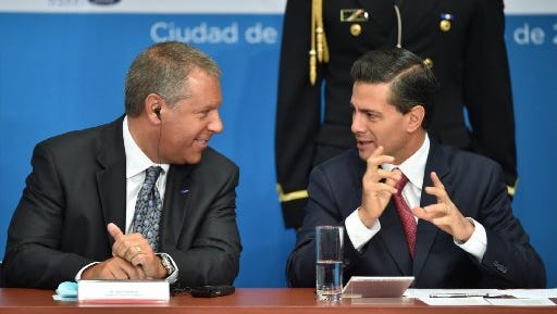 Ford Motor Company president for the Americas, Joseph Hinrichs (L) talks with Mexican President Enrique Pena Nieto during a press conference at Los Pinos presidential palace in Mexico City on April 17, 2015. The Ford Motor Company on Friday announced a $2.5 billion plan to expand factories in Mexico to make next-generation engines and transmissions. Speaking at an event alongside President Enrique Pena Nieto in Mexico's capital, Joseph Hinrichs, the company's president for the Americas region, said the projects in the states of Chihuahua and Guanajuato will create 3,800 direct jobs.