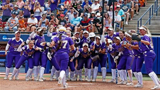 LSU's Kellsi Kloss, left, runs towards home plate where her teammates cheer for her following her home run in the third inning against Auburn in the NCAA Women's College World Series softball tournament in Oklahoma City, Thursday.