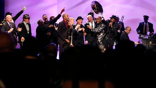 Musicians and speakers, including New Orleans Mayor Mitch Landrieu, Dr. John, John Boutte, John Cleary, Deacon John Moore, Jimmy Buffet, Boz Scaggs, Cyril Neville and the Preservation Hall Jazz Band sing a grand finale at a tribute for legendary  New Orleans composer and recording artist Allen Toussaint, who died last week at the age of 77, in New Orleans, Friday, Nov. 20, 2015. (AP Photo/Gerald Herbert)