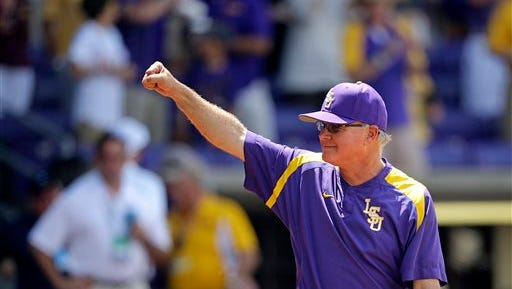 LSU head coach Paul Mainieri reacts to the crowd after defeating UNC Wilmington at the Baton Rouge Regional of the NCAA college baseball tournament in Baton Rouge last year.