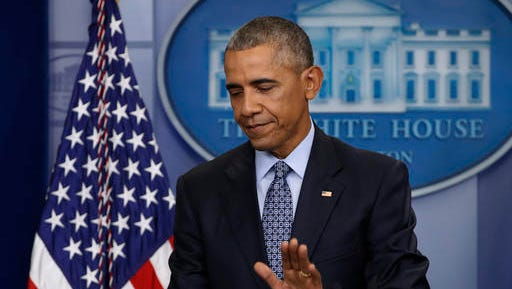 In this Jan. 18, 2017, photo, President Barack Obama taps the podium as he concludes his final presidential news conference in the briefing room of the White House in Washington. Eight tumultuous years at the helm of American power have come and gone, and for Obama, this is finally the end. The president is spending his last full day at the White House on Thursday before becoming an ex-president.