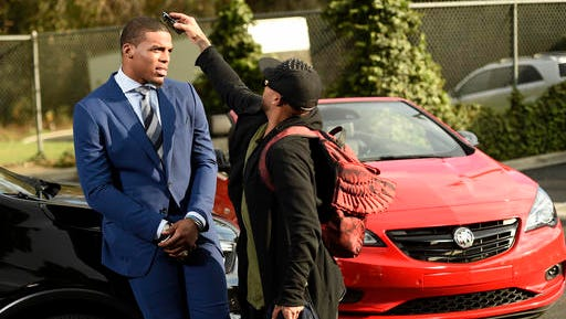 This Jan. 13, 2017 photo shows NFL player Cam Newton getting primped during the filming of a Buick commercial for this year's Super Bowl telecast  in Los Angeles. The commercial is set to air during the first quarter.