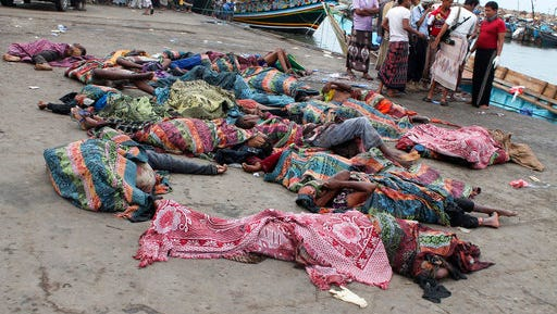 Bodies of Somali migrants, killed in attack by a helicopter while traveling in a boat off the coast of Yemen, lie on the ground at Hodeida city, Yemen, Friday, Mar. 17, 2017. A helicopter gunship attacked a boat packed with Somali migrants off the coast of Yemen overnight Thursday, killing at least 42 people, according to a U.N. agency, Yemeni officials and a survivor who witnessed the attack.