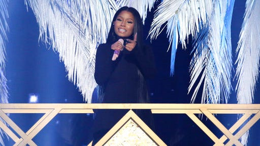 """FILE - In this Nov. 20, 2016 file photo, Nicki Minaj performs """"Do You Mind"""" at the American Music Awards at the Microsoft Theater  in Los Angeles.  The Wilhelmina talent and modeling agency has signed Nicki Minaj to its celebrity division. The agency said in a statement Wednesday, March 29, 2017 it will work to further the six-time American Music Award winner's influence in fashion and beauty."""