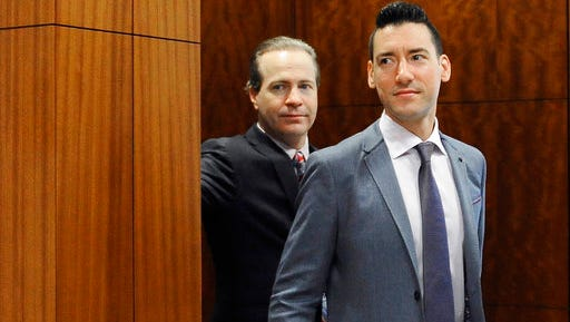 FILE - In this April 29, 2016 file photo, David Robert Daleiden, right, leaves a courtroom after a hearing in Houston. California prosecutors say two anti-abortion activists who made undercover videos of themselves trying to buy fetal tissue from Planned Parenthood have been charged with 15 felony counts of invasion of privacy. State Attorney General Xavier Becerra announced the charges Tuesday, March 28, 2017, against Daleiden and Sandra Merritt.