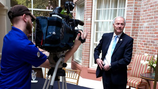 Arkansas Gov. Asa Hutchinson prepares for a TV station interview at the Governor's Mansion on Thursday, April 13, 2017, in Little Rock. The governor met with reporters to discuss a series of seven upcoming executions.