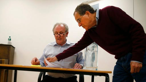 "Theatre director Nicholas Kent, right, and actor Peter Davison rehearse for the play ""All the President's Men?"" in London Thursday, April 20, 2017. Davidson will play US Secretary of State Rex Tillerson, during his Senate confirmation hearing. ""All The President's Men?"" is a stage drama based on the Senate confirmation hearings for several of President Donald Trump's Cabinet and will be staged in London and New York."