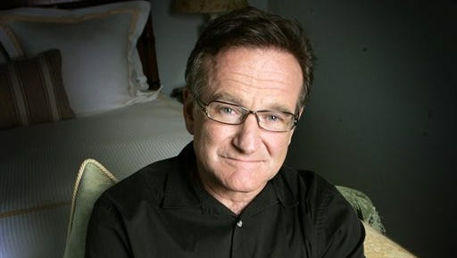 Actor and comedian Robin Williams posing for a photo in Santa Monica, Calif. Williams, whose free-form comedy and adept impressions dazzled audiences for decades, died Monday in an apparent suicide. Williams was 63.