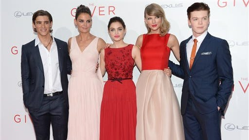"""Brenton Thwaites, Katie Holmes, Odeya Rush, Taylor Swift and Cameron Monaghan arrive at the New York premiere of """"The Giver"""" at the Zeigfeld Theater on Monday in New York."""