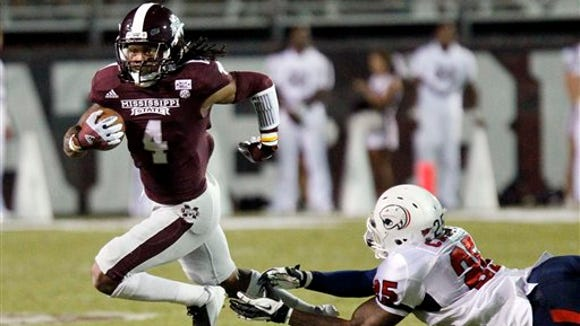Mississippi State wide receiver Jameon Lewis (4) runs out of an attempted tackle by South Alabama linebacker Clifton Crews (25) following a short yard reception in the third quarter of their NCAA college football game in Starkville, Miss., Saturday, Sept. 22, 2012. No. 23 Mississippi State won 30-10. (AP Photo/Rogelio V. Solis)