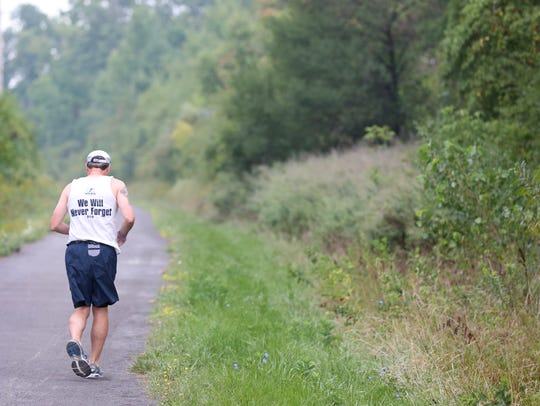 Bill Lawler runs down the Auburn Trail with wife Molly