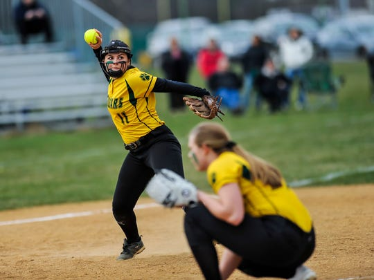 Montgomery third baseman Christine Willard throws to first base for an out in a game against North Hunterdon in Skillman on Apr. 12, 2018.