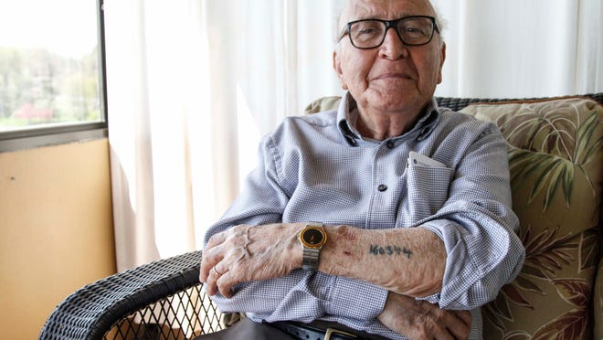 """David Wolnerman, 88, of Des Moines, and his wife, Jennie, are the last known survivors of the Nazi concentration camps left in central Iowa. Wolnerman is featured in """"A Lucky Lie,"""" a book by a 12-year-old West Des Moines girl describing his experiences."""