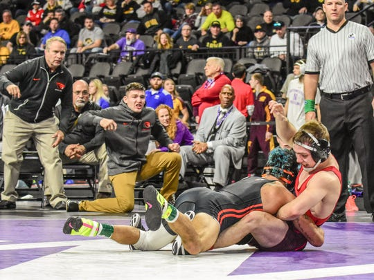 Oregon State's Ronnie Bresser connected on an inside trip to score a takedown and beat Iowa's Spencer Lee, 3-1, at the 55th annual Ken Kraft Midlands Championships on Saturday, Dec. 30, 2017, in Evanston, Illinois.