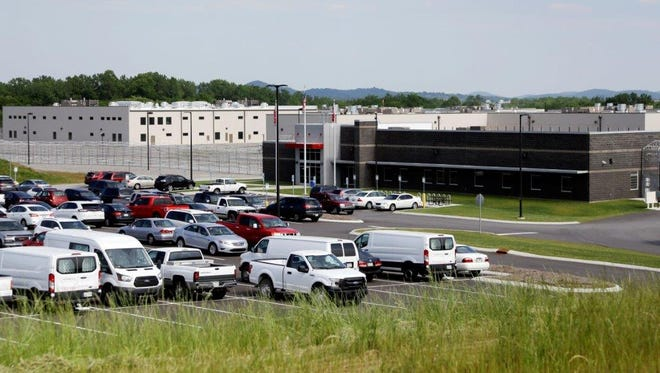 Trousdale Turner Correctional Center is shown Tuesday, May 24, 2016, in Hartsville, Tenn. Tennessee's newest prison has had to halt new admissions after just four months of full operation.