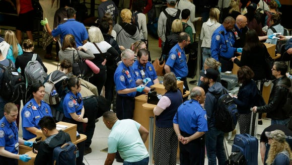 Transportation Security Administration officers check