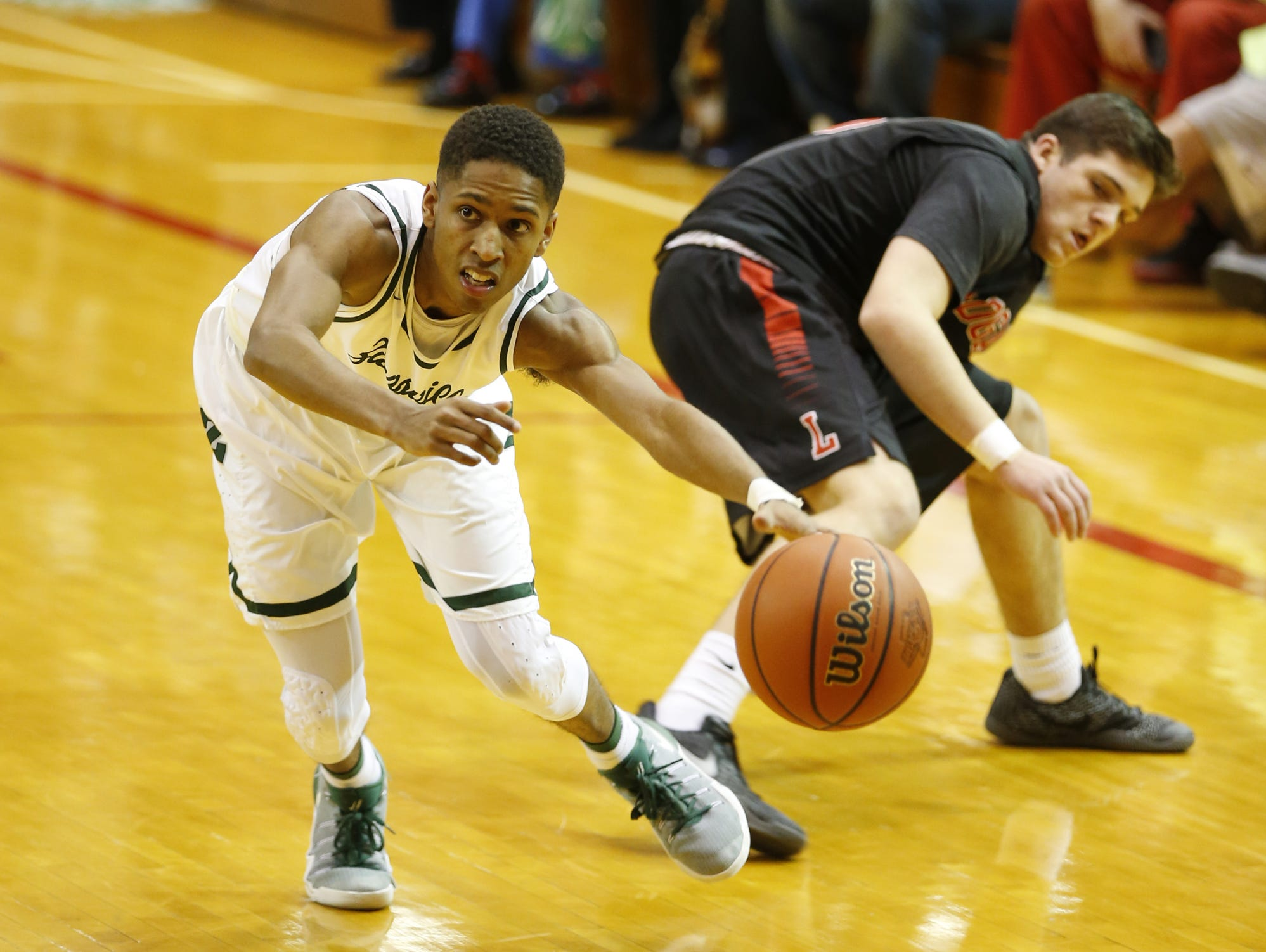 Isaiah Thompson of Zionsville gets around Jack Skaggs of Logansport Friday, March 3, 2017, in the Boys Basketball Sectional at Lafayette Jefferson High School in Lafayette.