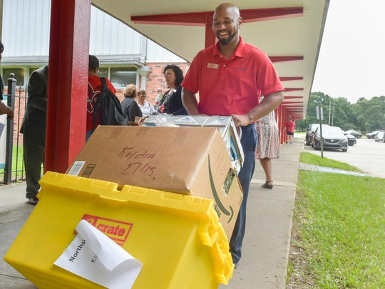 Another local company, Home Bank, adopted 10 Northside High teachers in 2017. Here, Linton Broussard delivers some supplies to classrooms at the school.