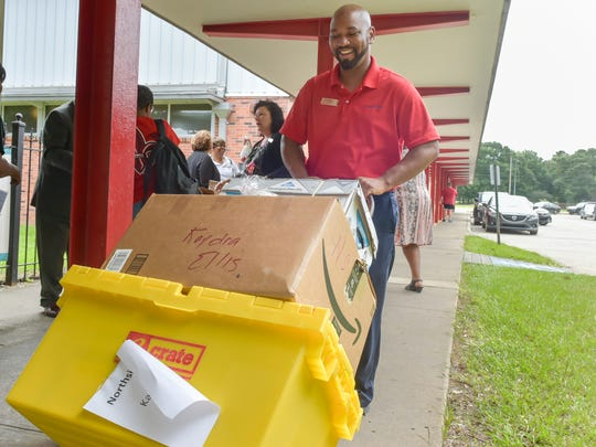 Linton Broussard delivers school supplies to classrooms. Home Bank adopts 10 Northside High School teachers and delivers school supplies to classrooms.. Monday, Aug. 7, 2017.