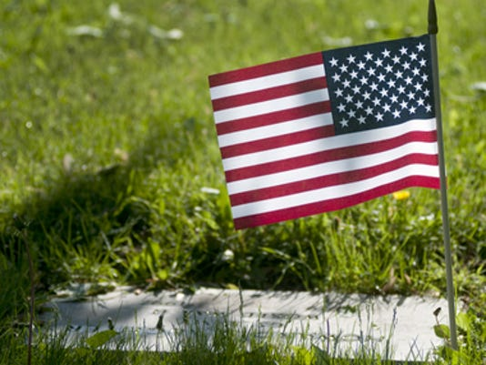 635681577236161369-American-flags-on-veterans-graves