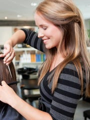Gov. Doug Ducey signed a bill reducing licensing requirements for many jobs in Arizona and plans to sign another soon that reduces licensing for hair stylists.
