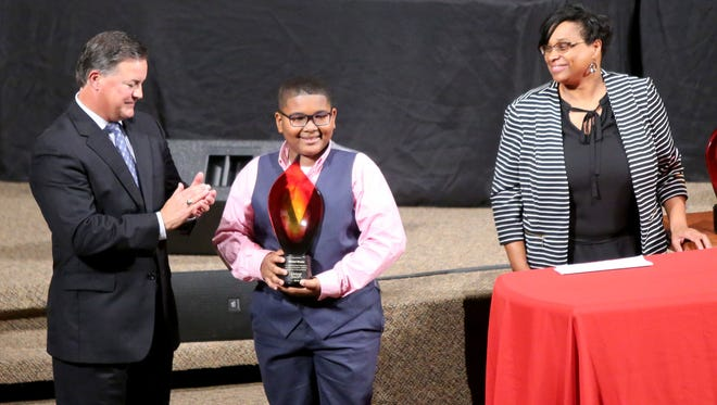 Michai Mosby is presented his Keeper of the Dream award the National Civil Rights Museum Student Forum.