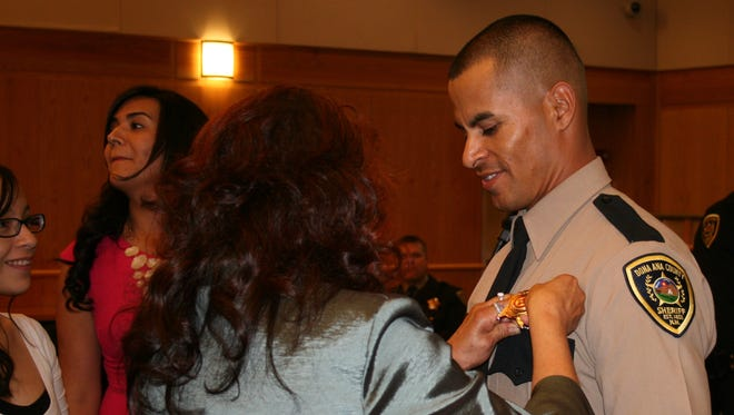 Jose Chavez is pinned during his graduation from the Dona Ana County Sheriff's Law Enforcement Academy on Oct. 31, 2013. The two- year veteran of the Hatch Police Department was shot during a traffic stop and later died at a hospital in El Paso. Jose Chavez is pinned during his graduation from the Dona Ana County Sheriff's Law Enforcement Academy on Oct. 31, 2013. The two- year veteran of the Hatch Police Department was shot during a traffic stop and later died at a hospital in El Paso.