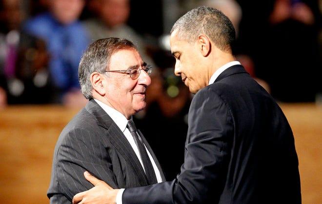 President Obama embraces Leon Panetta, left, in Arlington, Va., on Feb. 8.