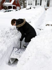Phyllis Brent clears a path so the mailman can reach
