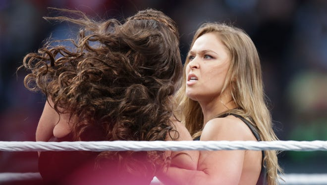 UFC fighter Ronda Rousey makes a surprise appearance at WrestleMania 31 on Sunday at Levi's Stadium in Santa Clara, Calif. WrestleMania broke the Levi's Stadium attendance record at 76,976 fans from all 50 states and 40 countries.
