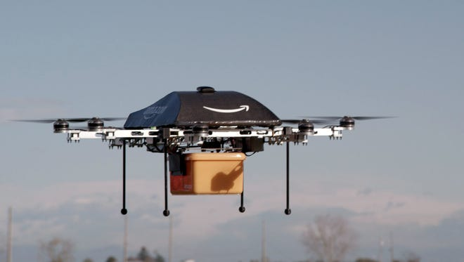 "This undated handout photo released by Amazon on December 1, 2013 shows a flying ""octocopter"" mini-drone that would be used to fly small packages to consumers. Amazon CEO Jeff Bezos revealed on December 1 that his company was looking to the future with plans to use mini-drones to deliver small packages. A new study shows that most are against personal or commercial drones in U.S. airspace. CLIENTSAMAZON/AFP/Getty Images"