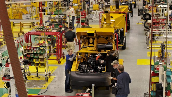 Employees at Vermeer Corp. assemble a BC1500 brush chipper at Plant No. 4 in Pella on Tuesday, Nov. 1, 2011 in this file photo.