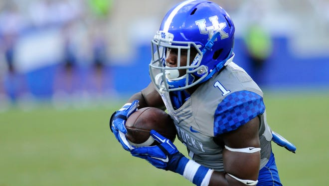 Ryan Timmons catches a pass against Ohio, Saturday, Sept. 06, 2014, at Commonwealth Stadium in Lexington.