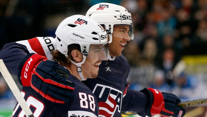 USA defender Seth Jones, right, and forward Peter Mueller celebrate a goal during the Group B preliminary round match between USA and Kazakhstan at the Ice Hockey World Championship in Minsk, Belarus, on Friday.