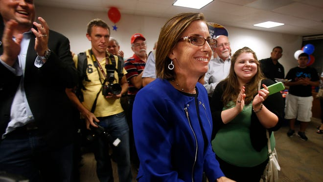Martha McSally, a former Air Force colonel who is running for Congress, is decrying an ad that says she opposes making it harder for stalkers to get guns. McSally said she has been stalked and wants the ad removed.