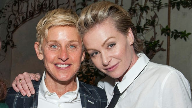 """Ellen DeGeneres and Portia de Rossi attend Arianna Huffington's """"Thrive""""  book party hosted by Victoria Jackson, Kathy Freston And Dean Ornish on May 8, 2014, in Beverly Hills, Calif."""