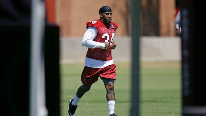 Arizona Cardinals' Ryan Williams runs during training Camp Sunday, Aug. 11, 2013 in Tempe.