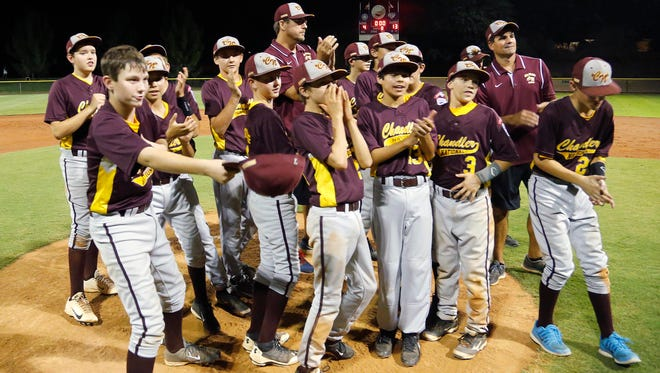 Chandler National celebrates their 13-4 win over Gilbert American during the Arizona state Little League championship on Wednesday, July 23, 2014, in Peoria.