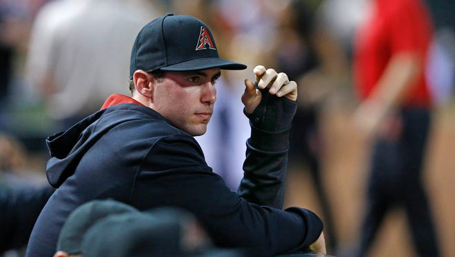 Diamondbacks first baseman Paul Goldschmidt (44) watches the action with a cast on his had from the dugout during the 2nd inning of their MLB game against the Pittsburgh Pirates  Saturday, Aug. 2, 2014 in Phoenix, Ariz.