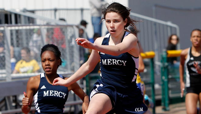 Mercy's Emily Wade, right, takes first place, just ahead of teammate Alana Morrow in the 400-meter hurdles during the Webster Invitational on Saturday at Webster Thomas.
