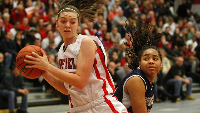 Penfield's Lucy Covley, left, pulls in a rebound against Gates Chili's Diona Johnson during the Section V Class AAA championship game in 2012.