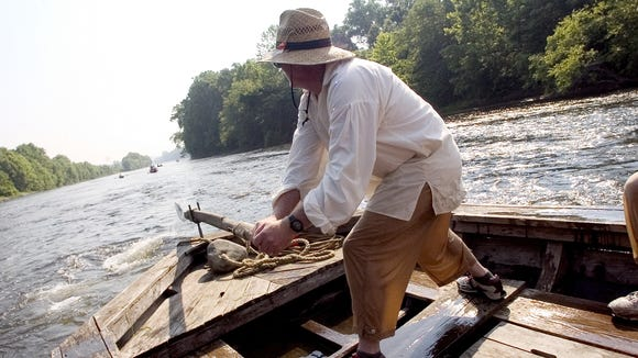 Jerry Martin of Stuarts Draft steers the front of the 43-foot-long Virginia Creeper through rough water on a stretch of the James River just east of Stapleton in June 2006.