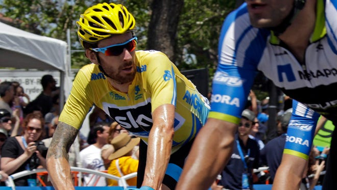 Bradley Wiggins, of Great Britain, crosses the finish line as the overall winner of the final stage of the Tour of California cycling race, in Thousand Oaks, Calif.