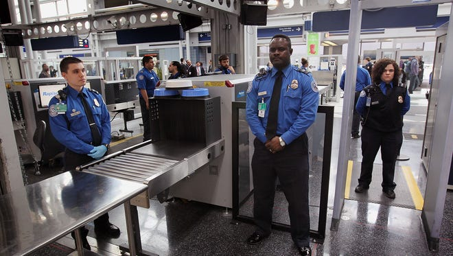 TSA officers staff a checkpoint at Chicago's O'Hare International Airport.