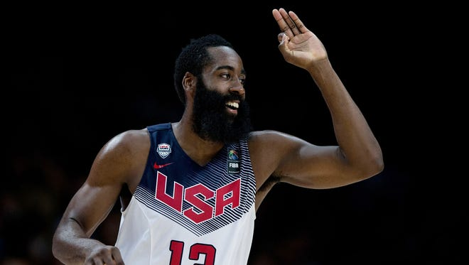 James Harden of Team USA smiles after a three-pointer during the FIBA World Cup championship game Sunday in Madrid against Serbia.
