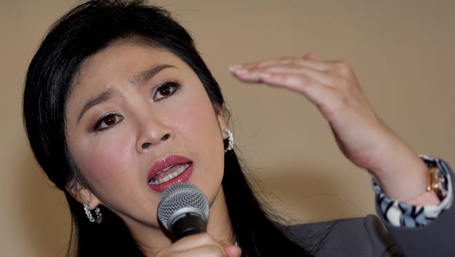 Prime Minister Yingluck Shinawatra gestures as she answers questions during an interview with the foreign media at the office of Permanent Secretary for Defense on the outskirts of Bangkok, Thailand.