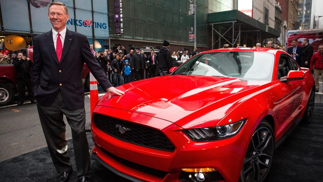 Alan Mulally, CEO of Ford, poses next to the 2015 Ford Mustang on the set of Good Morning America on December 5, 2013 in New York City.
