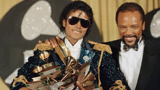 Michael Jackson and Quincy Jones at the Grammy Awards at Shrine Auditorium, Feb. 28, 1984, in Los Angeles.