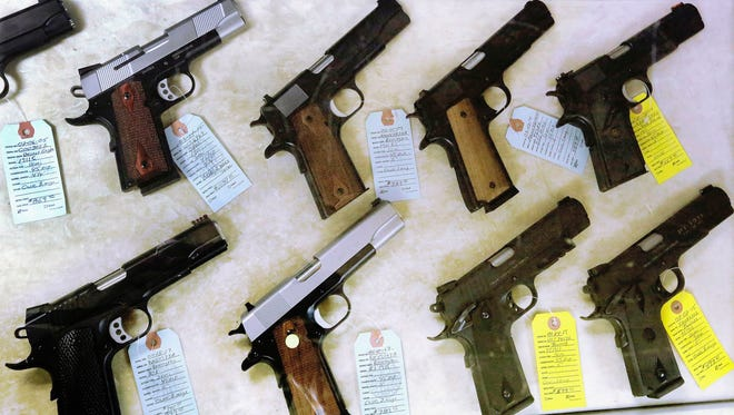 Semiautomatic handguns are displayed last year at Capitol City Arms Supply in Springfield, Ill.