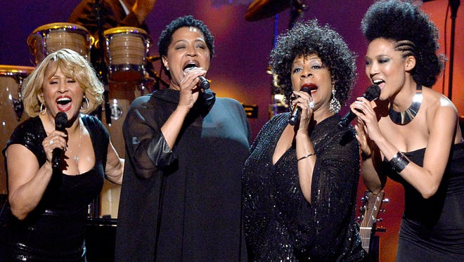 Singers Darlene Love, Lisa Fisher, Merry  Clayton and Judith Hill perform at the 2014 MusiCares Person Of The Year gala honoring Carole King Friday in Los Angeles.